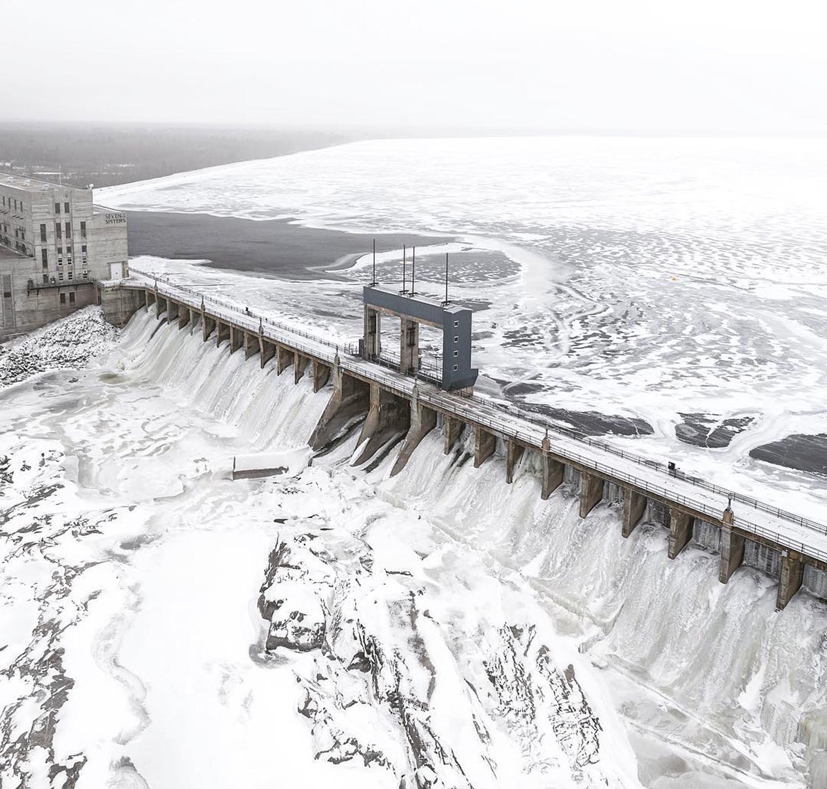 Arial photo of a generating station in winter with snow and ice.